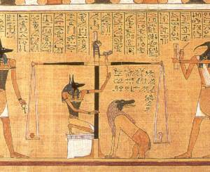The deceased's heart weighed against the feather of truth. From the Papyrus of Hunefer, ca. 1350 BCE.
